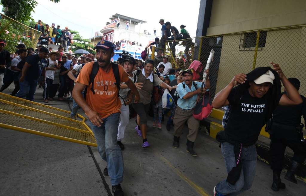 Migrants storm into Mexico